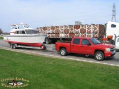 boat_on_trailer_with_truck.jpg